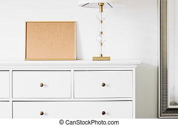 Golden horizontal frame for art, poster or photo in white interior, home decor