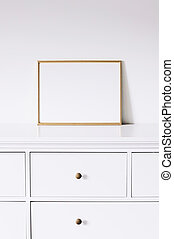 Golden horizontal frame on white furniture, luxury home decor and design for mockup creation