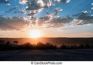 Golden hour on sandy hill in Cappadocia