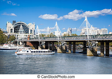 Golden Jubilee Bridge with boat in London, England, UK