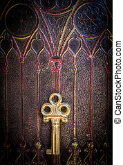 Golden Key on Ancestral Book Cover - Old golden metal key...