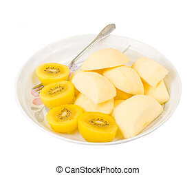 Golden kiwi fruit and sliced apple with fork