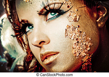 Golden lady - Vogue style portrait of a woman with gold...