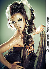 Golden lady - Vogue style portrait of a woman with...