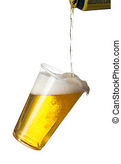 Golden beer, ale or lager in a tilting plastic disposable cup or glass with beer being poured from can and spilling over edge of pint