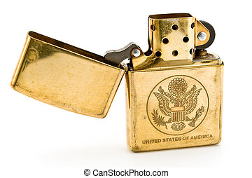 Golden lighter with carved United States seal isolated on white