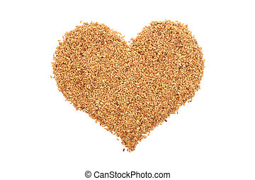 Golden linseed in a heart shape