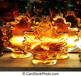 golden maple syrup in a glass bottle