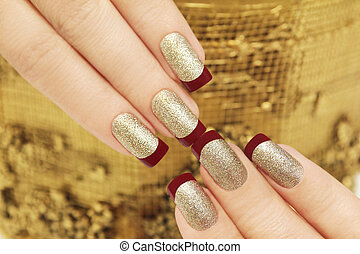 Golden maroon French manicure.
