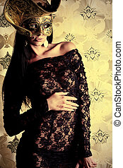 golden mask - Shot of a sexy woman in erotic lingerie over...