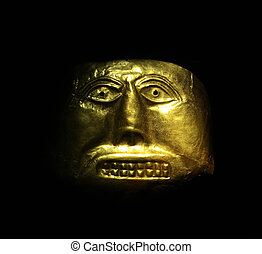 Golden mask in the Gold Museum, Bogota, Colombia. Tolima...