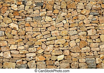 Golden masonry stone wall from old building contruction facade