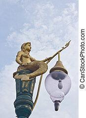 Golden mermaid light poles