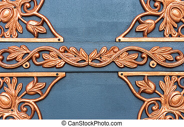 Golden metal lattice on steel background