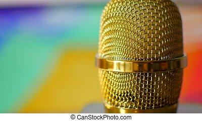 Golden microphone in a recording studio.
