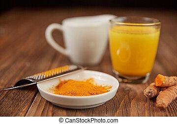 Golden milk with turmeric powder, clean eating detox concept  Golden