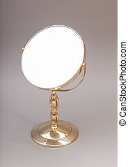 Golden mirror isolated on gray background