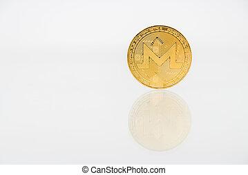 Golden Monerd coin with reflection on the table, online digital currency. Concept of block chain, market uprise