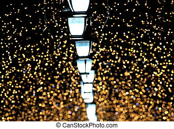 Golden night lights . Beautiful blurred background.