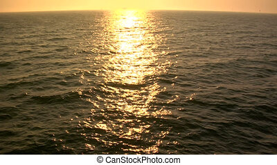 Golden Ocean slomo - This is a slow motion shot of golden...