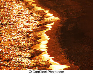 Golden ocean waves at sundown