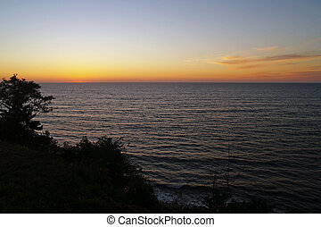 Golden Orange Sunset in a Clear Sky Over the Ocean