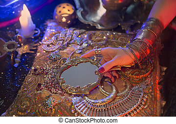 Golden Oriental Jewelry and Accessories: Female Hands with Indian Jewellery
