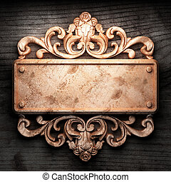 golden ornament on wood