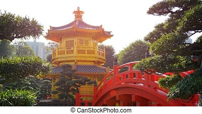 Beautiful golden pagoda and ornate bridge in the famous garden park of the Chi Lin Nunnery in Hong Kong.