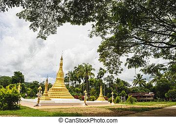 Golden pagoda mixed arts Thailand - Burma in in Thai temple.