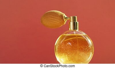 Golden perfume bottle and light flares, chic fragrance scent as luxury product for cosmetic and beauty brand, stock footage