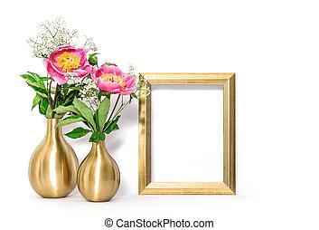 Golden picture frame pink flowers. Minimal decoration