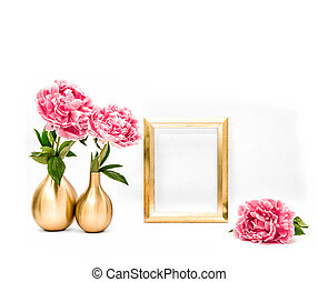 Golden picture frame pink peony flowers. Minimal decoration