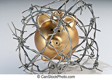 Golden piggy bank secured with barbed wire.