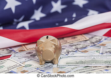 Golden Piggy Bank on Dollars with American Flag