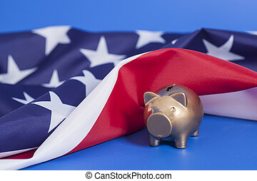 Golden Piggy Bank  with American Flag on blue background