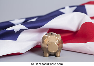 Golden Piggy Bank  with American Flag on gray background