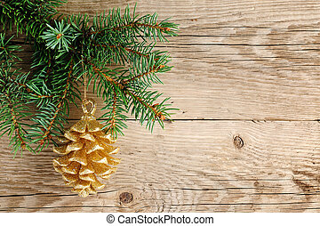 Golden pine cone on christmas tree