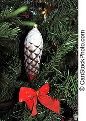Golden pine cone. vintage christmas toys on new year tree background.