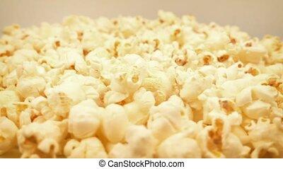 Golden Popcorn Rotating In Bowl