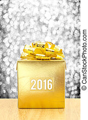 Golden Present box with 2016 word year at silver bokeh light background, Leave space for adding your text.