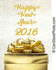 Golden Present box with Happy New Year 2016 word at bokeh light background, Holiday concept