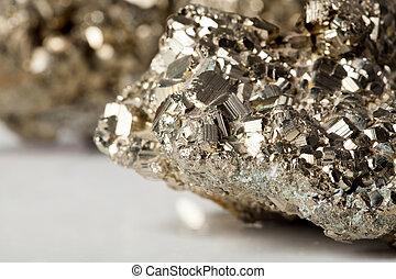 Golden pyrite stone specimen with shiny reflections