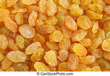 Golden raisin background - view of golden raisins, close-p