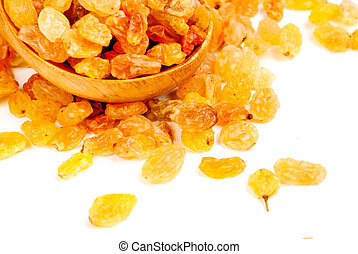 Golden raisins close- up and wooden spoon, isolated on white background