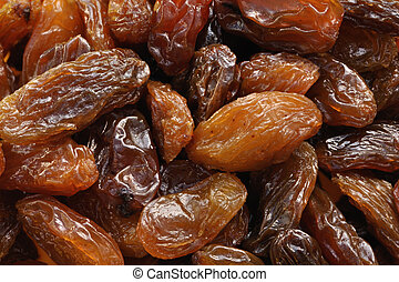 Golden raisins - Macro closeup of pile of golden raisins