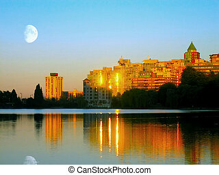Golden Reflection - A sunset scene at Lost Lagoon,...
