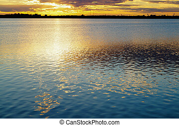 Golden reflection sunset over lake background