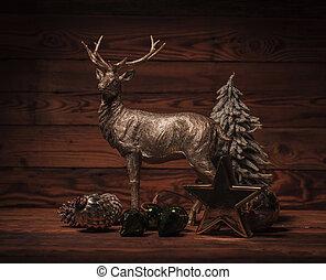 golden reindeer near christmas decorations