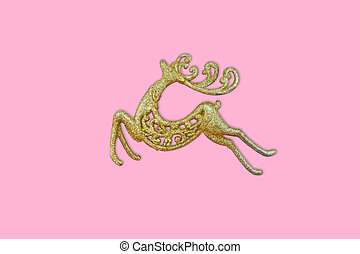 Golden Reindeer on pink background with copy space. New year, Christmas concept